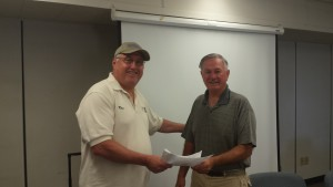Kris handing Pat Dwyer_EDCFSC the PRFSC affliliation papers